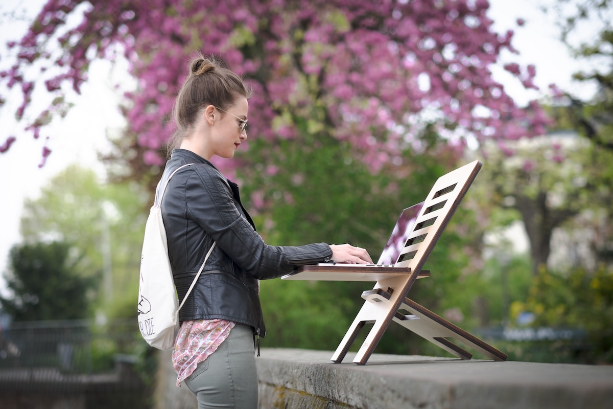 Female using cloud technology on a mobile workstation