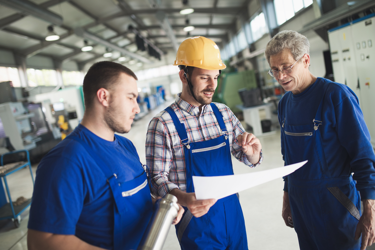 Supplier Relationship Management Supplier with engineer checking on production in factory